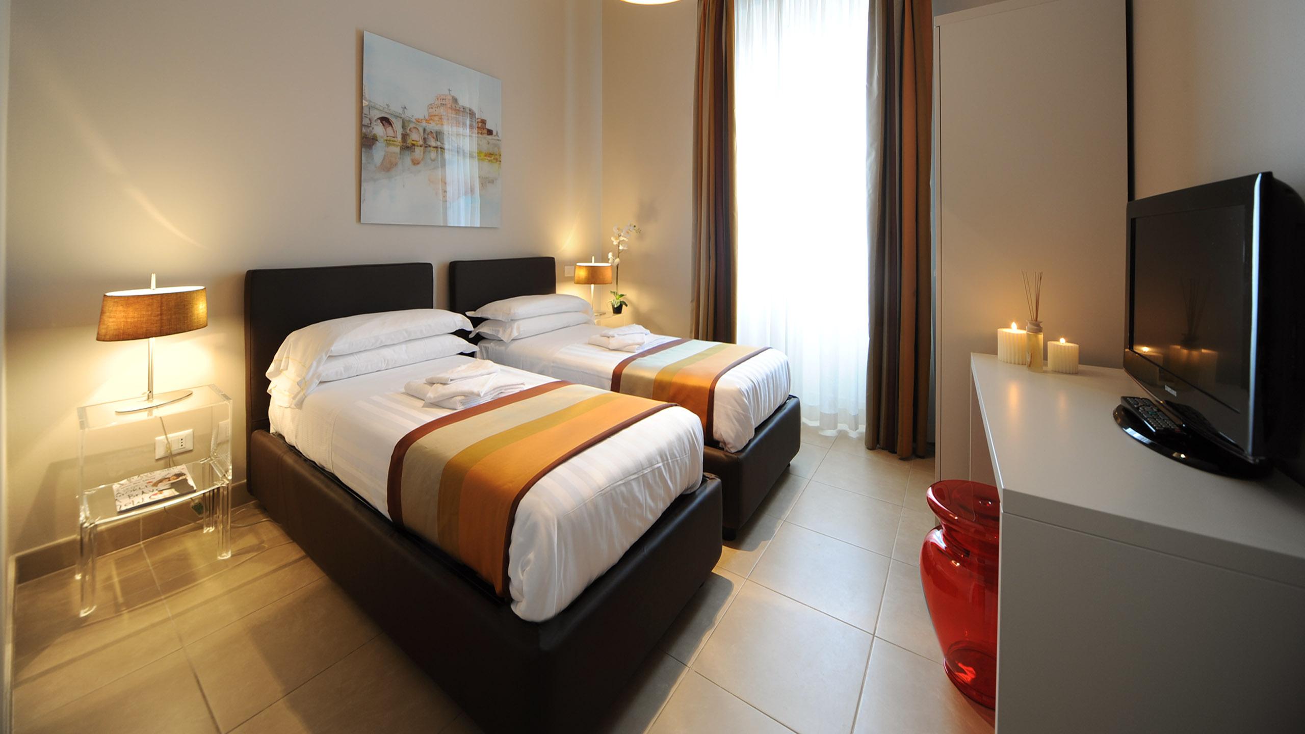 Residence-Trianon-Borgo-Pio-Roma-appartamento-due-stanze-2020-letto